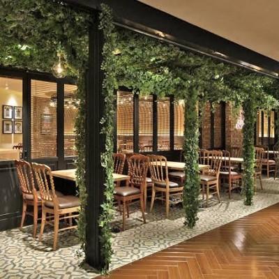 当日会場店舗  ピッツア&ワインバール エントラータ ナビオ店  お店イメージ写真。 オシャレな個室居酒屋さんです。